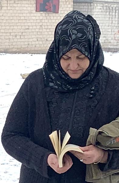 Idlib woman with Bible