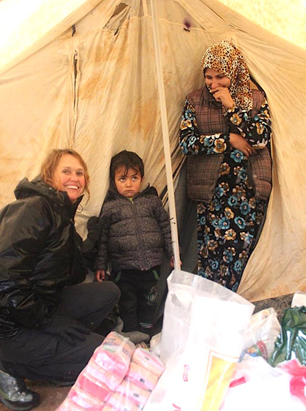 Karen with one of the families in their tent.