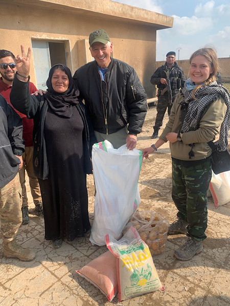 Helping give food to displaced people near Tel Tamir