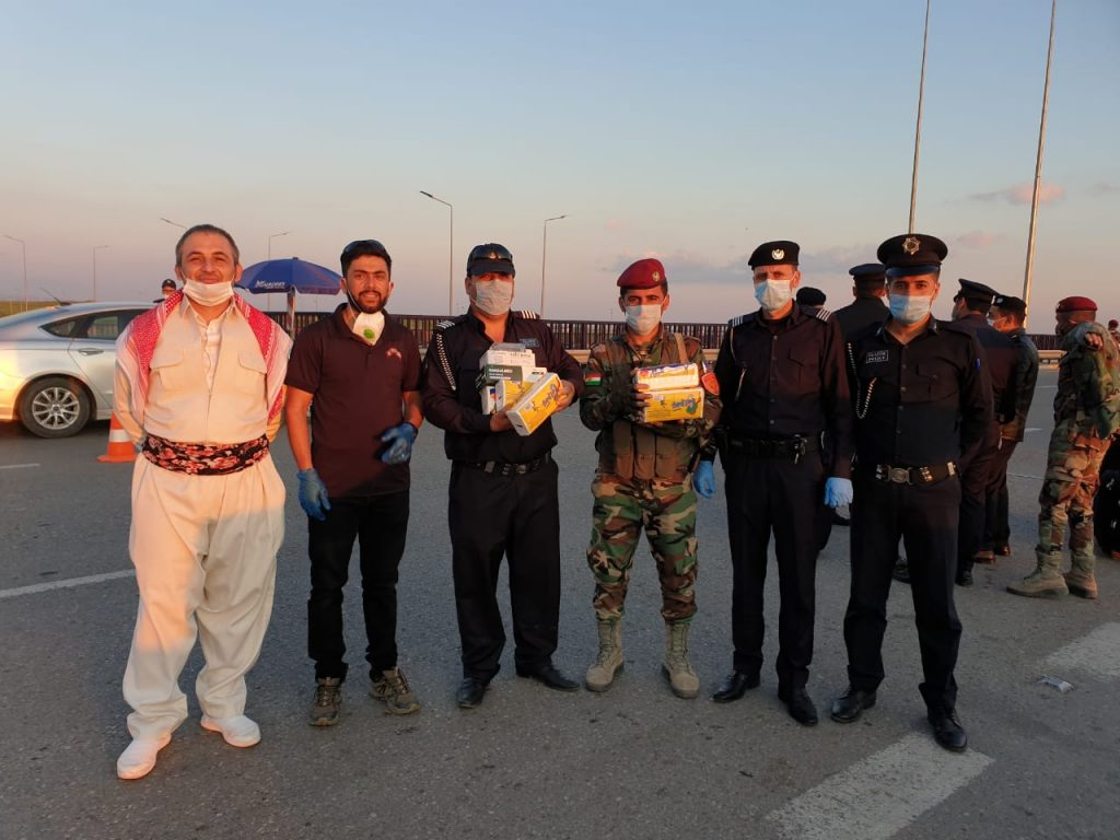 FBR team giving supplies to troops and police in Erbil.