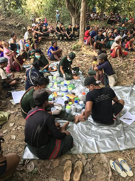 Rangers provide medical care to Karen villagers