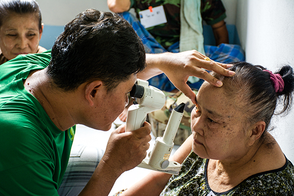 Nay Hser checks a Karen villager for possible cataracts.