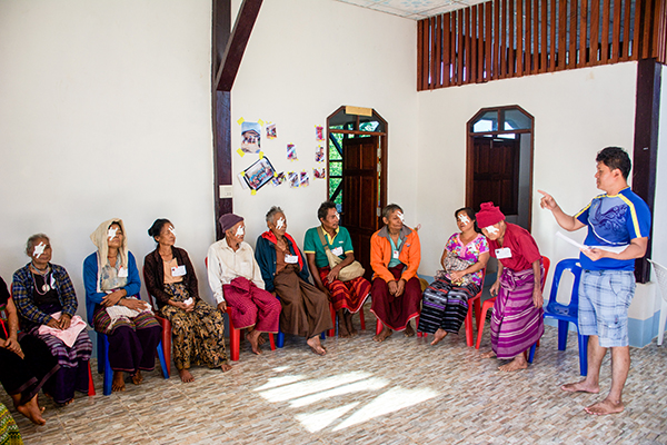 Nay Hser delivers post-op instructions to patients who had undergone cataract surgery the day before.