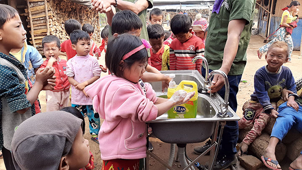 Children wash their hands after a lesson on good health and hygiene during a Good Life Club program.