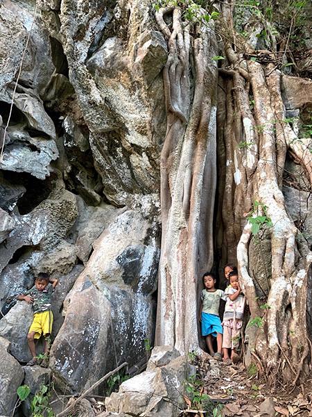 Children hiding from Burma Army shellings in caves near Ler Mu Plaw.