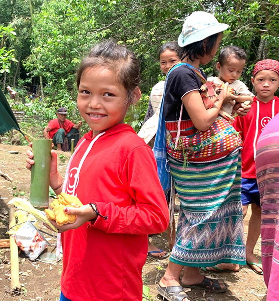 A child displaced by the Burma Army enjoys lunch during a Good Life Club program.