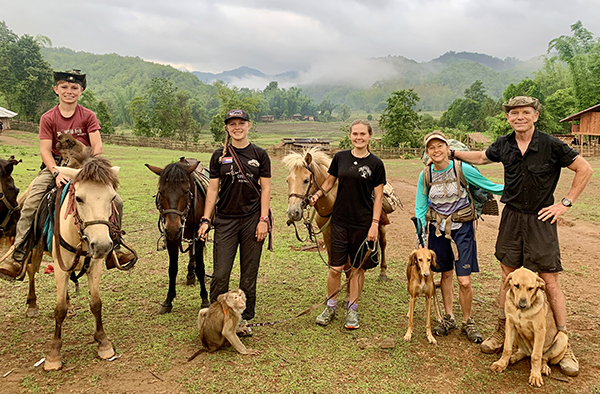 Pictured from left to right: Peter, Suu, Sahale, Karen, and Dave along with Kid the Monkey, dogs Ninevah and Mahji, and some of the horse/mule team during a recent mission in Karen State, Burma.
