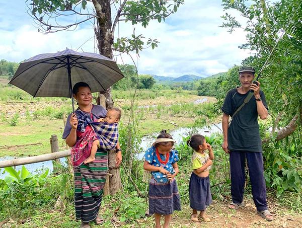 A family checks the radio for news of Burma Army movement near Ye Mu Plaw.