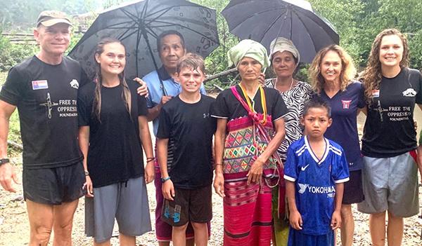 With widow Naw Yu Mer (center) whose husband was killed here near Saw Mu Plaw by the Burma army