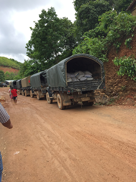 Burma Army trucks carrying rice between camps.