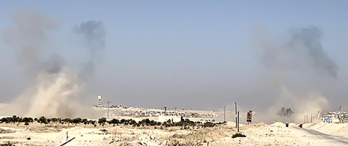 Mortar impacts from Turkish strikes near Ein Issa, northeastern Syria.