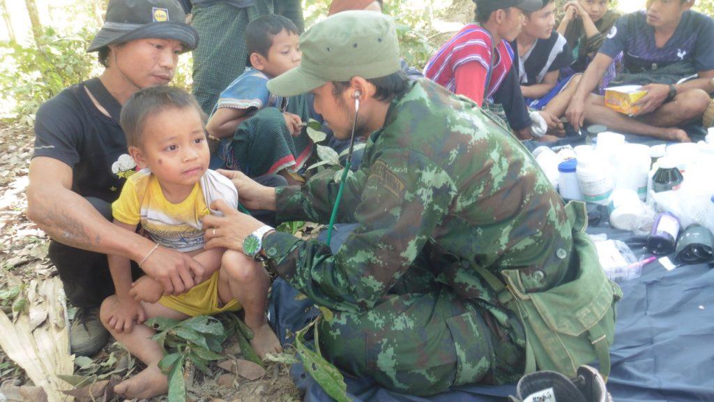 FBR medic treats a sick child