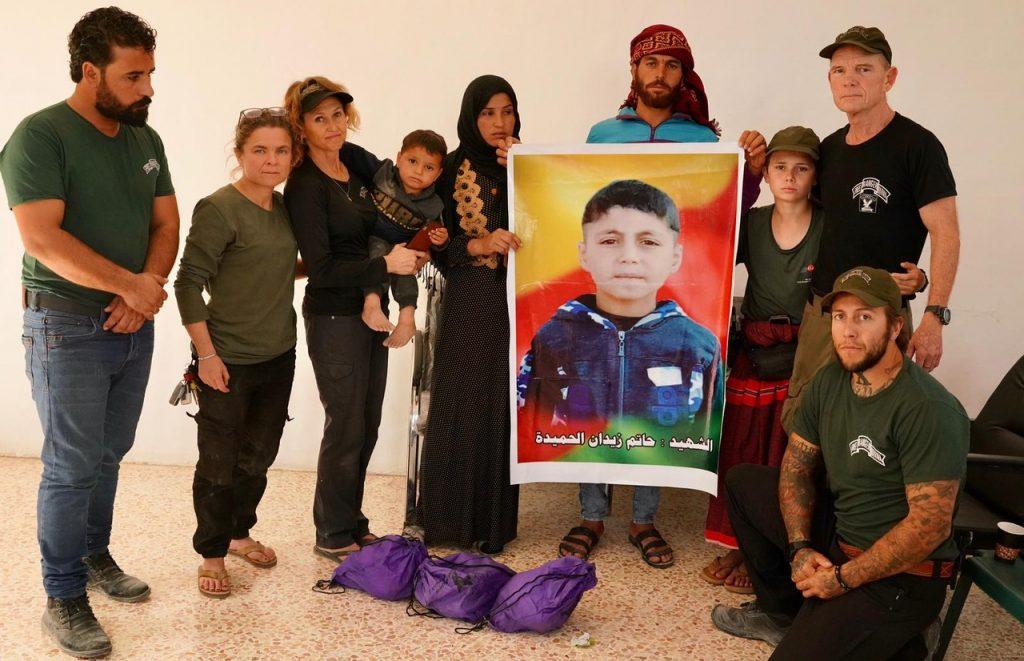Hamdu helping us to comfort Hatam's family in Ein Issa
