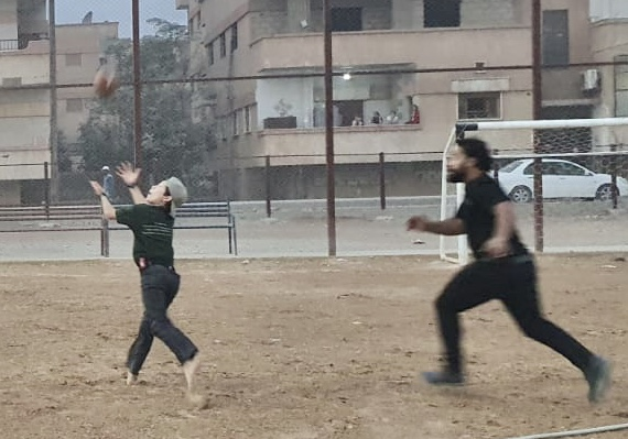 Trying to cover Pete in football at Zau Seng Memorial Field in Hasaka