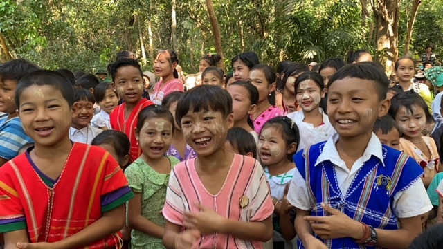 village children gather for GLC