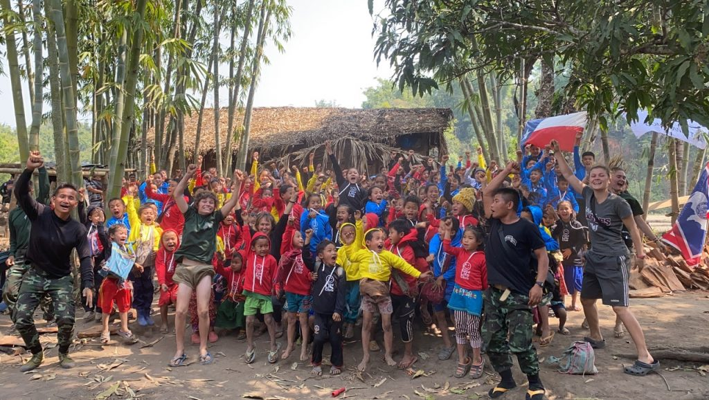 Displaced children and team members sing together