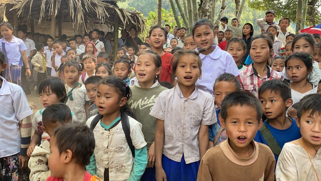 Displaced children sing together near Tha Kaw Tho Baw, Luthaw, Karen State