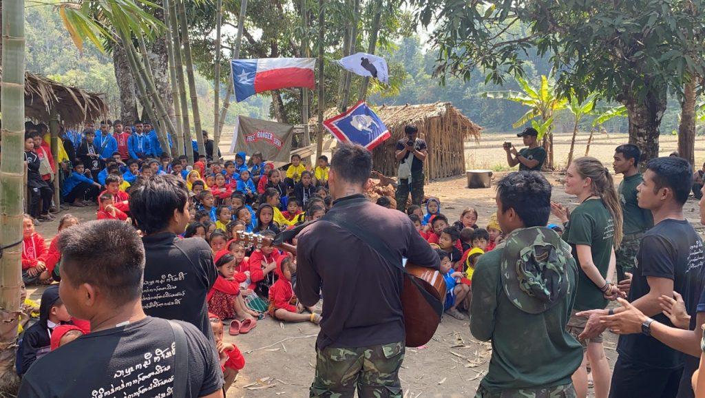Unity in the jungle as Arakan, Karenni and Karen team members sing for the displaced children