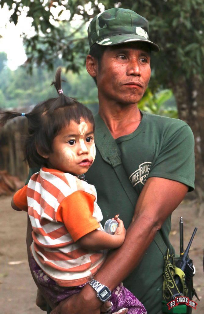 brilliant eyes Karen soldier with child